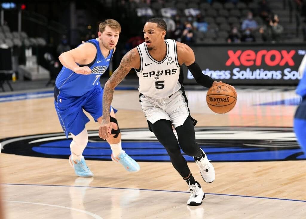 DALLAS, TX - APRIL 11: Dejounte Murray #5 of the San Antonio Spurs dribbles against the Dallas Mavericks on April 11, 2021 at the American Airlines Center in Dallas, Texas. NOTE TO USER: User expressly acknowledges and agrees that, by downloading and or using this photograph, User is consenting to the terms and conditions of the Getty Images License Agreement. Glenn James/NBAE via Getty Images
