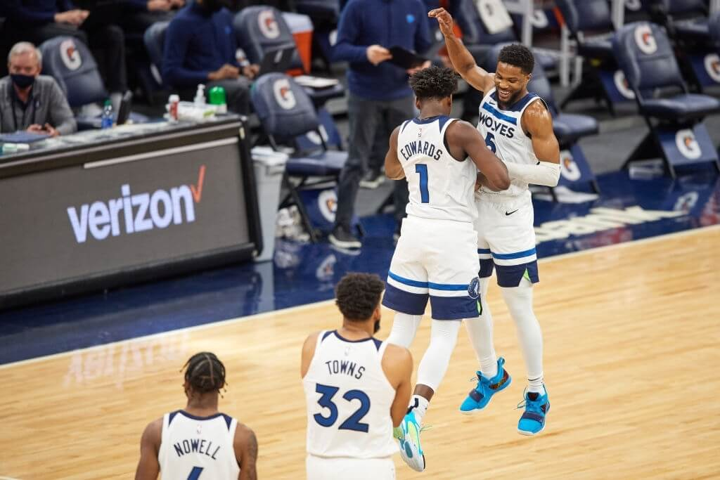 MINNEAPOLIS, MINNESOTA - MARCH 31: Malik Beasley #5 of the Minnesota Timberwolves congratulates teammate Anthony Edwards #1 during the game at Target Center on March 31, 2021 in Minneapolis, Minnesota. The Timberwolves defeated the Knicks 102-101. NOTE TO USER: User expressly acknowledges and agrees that, by downloading and or using this Photograph, user is consenting to the terms and conditions of the Getty Images License Agreement (Photo by Hannah Foslien/Getty Images)