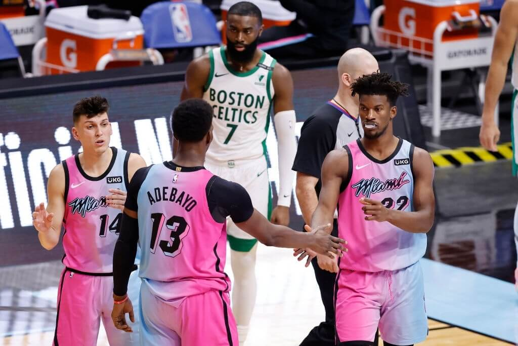 MIAMI, FLORIDA - JANUARY 06: Jimmy Butler #22 of the Miami Heat high fives Bam Adebayo #13 against the Boston Celtics during the fourth quarter at American Airlines Arena on January 06, 2021 in Miami, Florida. NOTE TO USER: User expressly acknowledges and agrees that, by downloading and or using this photograph, User is consenting to the terms and conditions of the Getty Images License Agreement. (Photo by Michael Reaves/Getty Images)