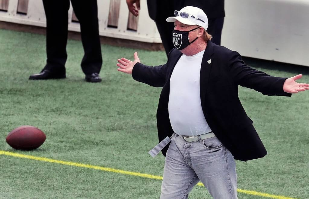 FOXBOROUGH, MA - SEPTEMBER 27: Las Vegas Raiders owner Mark Davis reacts as he sees Patriots owner Robert Kraft (not pictured) walking across the field to greet him on the visitor's sideline before the game. The New England Patriot host the Las Vegas Raiders in an NFL regular season football game at Gillette Stadium in Foxborough, MA on Sept. 27, 2020. (Photo by Jim Davis/The Boston Globe via Getty Images)