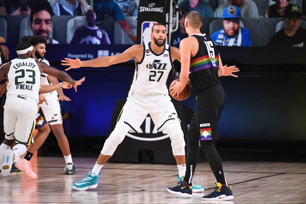 ORLANDO, FL - AUGUST 19: Rudy Gobert #27 of the Utah Jazz plays defense against Nikola Jokic #15 of the Denver Nuggets during Round One, Game Two of the NBA Playoffs on August 19, 2020 at the AdventHealth Arena at ESPN Wide World Of Sports Complex in Orlando, Florida. NOTE TO USER: User expressly acknowledges and agrees that, by downloading and/or using this Photograph, user is consenting to the terms and conditions of the Getty Images License Agreement. Mandatory Copyright Notice: Copyright 2020 NBAE (Photo by Garrett Ellwood/NBAE via Getty Images)