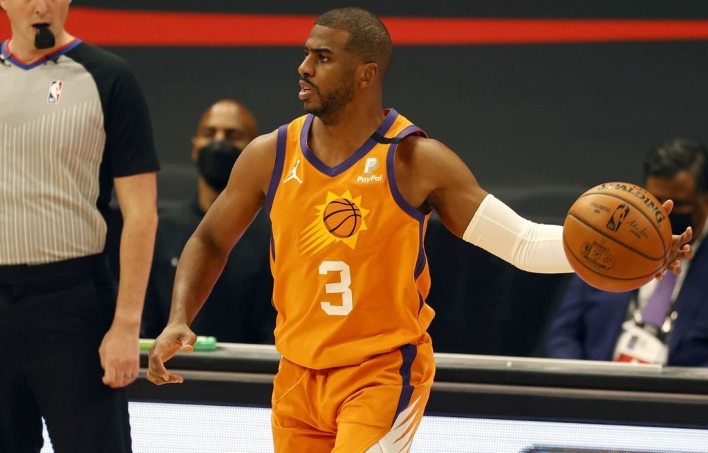 Mar 26, 2021; Tampa, Florida, USA; Phoenix Suns guard Chris Paul (3) drives to the basket against the Toronto Raptors during the first half at Amalie Arena. Mandatory Credit: Kim Klement-USA TODAY Sports