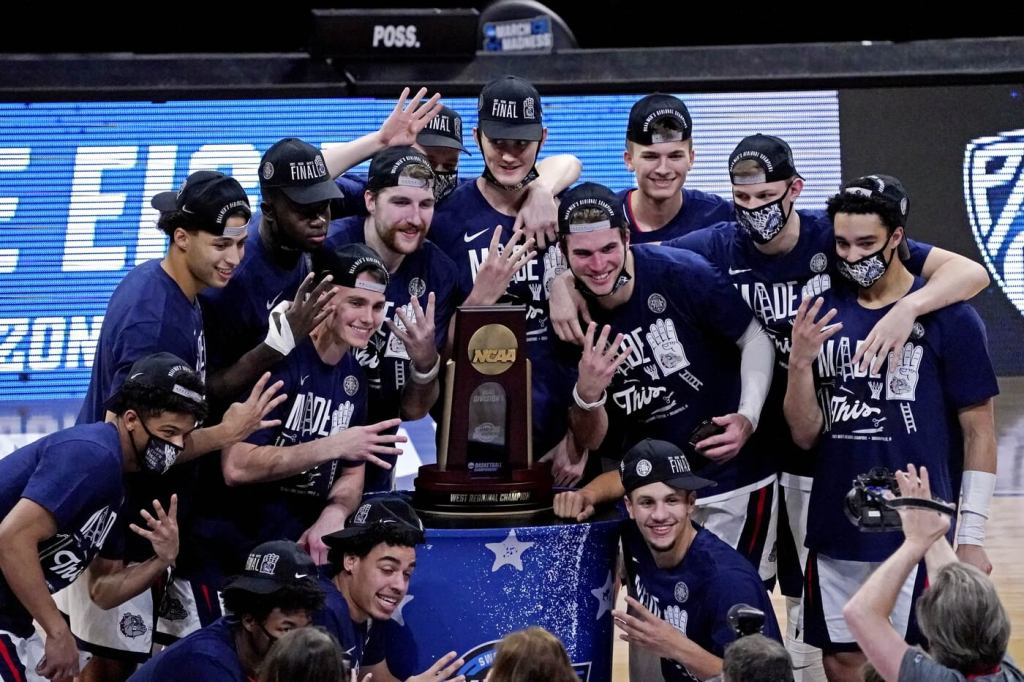 Mar 30, 2021; Indianapolis, IN, USA; The Gonzaga Bulldogs celebrate beating the USC Trojans in the Elite Eight of the 2021 NCAA Tournament at Lucas Oil Stadium. Mandatory Credit: Robert Deutsch-USA TODAY Sports