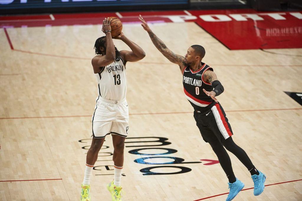 Mar 23, 2021; Portland, Oregon, USA; Portland Trail Blazers guard Damian Lillard (0) defends Brooklyn Nets guard James Harden (13) during the first half at Moda Center. Mandatory Credit: Troy Wayrynen-USA TODAY Sports