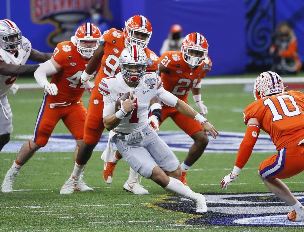 Jan 1, 2021; New Orleans, LA, USA; Ohio State Buckeyes quarterback Justin Fields (1) rushes upfield during the second quarter of the College Football Playoff semifinal against the Clemson Tigers at the Allstate Sugar Bowl in the Mercedes-Benz Superdome in New Orleans on Friday, Jan. 1, 2021. Mandatory Credit: Adam Cairns-USA TODAY Sports