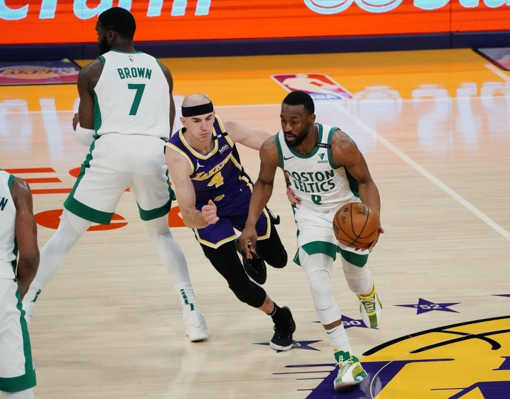 Apr 15, 2021; Los Angeles, California, USA; Boston Celtics guard Kemba Walker (8) moves the ball as guard Jaylen Brown (7) provides coverage against Los Angeles Lakers guard Alex Caruso (4) during the first half at Staples Center. Mandatory Credit: Gary A. Vasquez-USA TODAY Sports