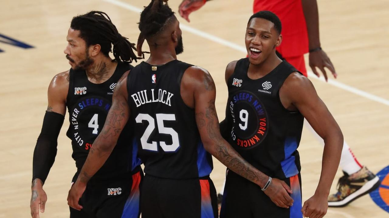 Apr 24, 2021; New York, New York, USA; New York Knicks guard RJ Barrett (9) celebrates with guard Derrick Rose (4) and New York Knicks forward Reggie Bullock (25) against the Toronto Raptors during the second half of an NBA basketball game Saturday, April 24,2021, in New York. Mandatory Credit: Noah K. Murray/Pool Photo-USA TODAY Sports