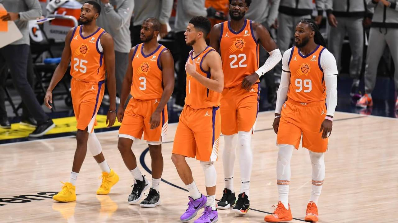 Jan 1, 2021; Denver, Colorado, USA; Phoenix Suns forward Mikal Bridges (25) and guard Chris Paul (3) and Phoenix Suns guard Devin Booker (1) and center Deandre Ayton (22) and forward Jae Crowder (99) react following a fourth quarter time out against the Denver Nuggets at Ball Arena. Mandatory Credit: Ron Chenoy-USA TODAY Sports