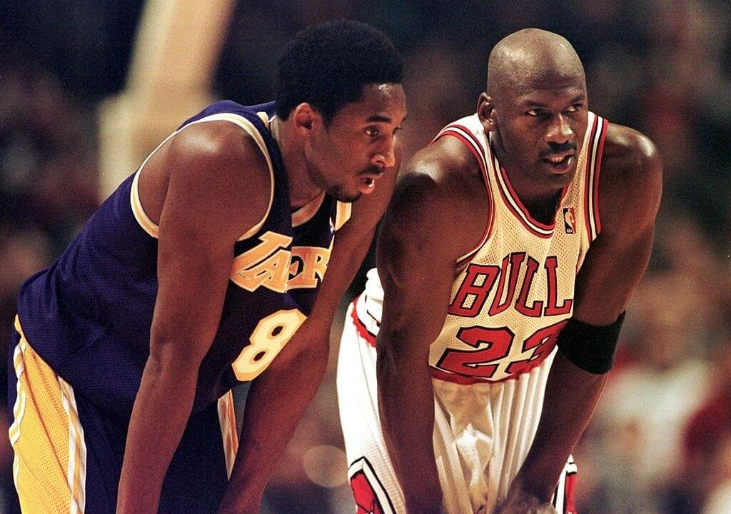 CHICAGO, UNITED STATES: Los Angeles Lakers guard Kobe Bryant(L) and Chicago Bulls guard Michael Jordan(R) talk during a free-throw attempt during the fourth quarter 17 December at the United Center in Chicago. Bryant, who is 19 and bypassed college basketball to play in the NBA, scored a team-high 33 points off the bench, and Jordan scored a team-high 36 points. The Bulls defeated the Lakers 104-83. AFP PHOTO VINCENT LAFORET
