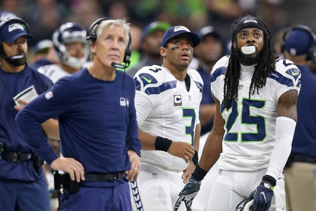 Oct 30, 2016; New Orleans, LA, USA; Seattle Seahawks head coach Pete Carroll and quarterback Russell Wilson (3) and cornerback Richard Sherman (25) watch from the sidelines in the second quarter against the New Orleans Saints at the Mercedes-Benz Superdome. Mandatory Credit: Chuck Cook-USA TODAY Sports