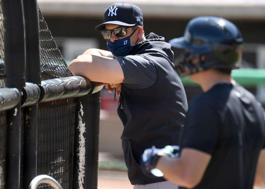 Mar 11, 2021; Clearwater, Florida, USA; New York Yankees manager Aaron Boone (17) watches his team take batting practice before the game against the Philadelphia Phillies during spring training at BayCare Ballpark. Mandatory Credit: Jonathan Dyer-USA TODAY Sports