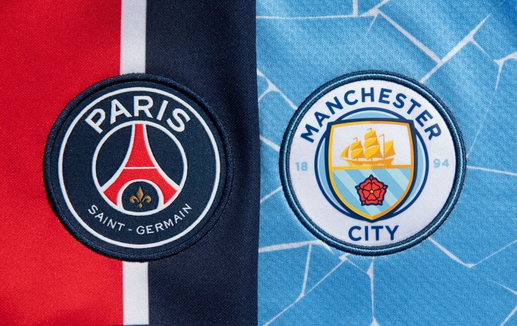 MANCHESTER, ENGLAND - MARCH 30: The Paris Saint-Germain and Manchester City club badges on their first team home shirts on March 30, 2021 in Manchester, United Kingdom.