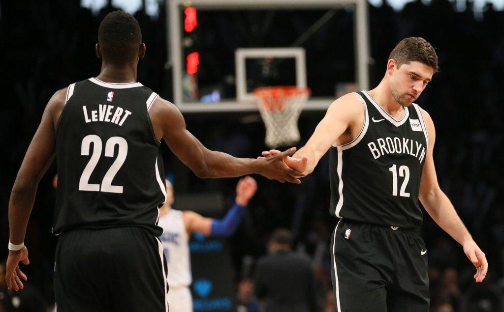 Jan 1, 2018; Brooklyn, NY, USA; Brooklyn Nets guard Caris LeVert (22) and guard Joe Harris (12) react in the third quarter against Orlando Magic at Barclays Center. Mandatory Credit: Nicole Sweet-USA TODAY Sports