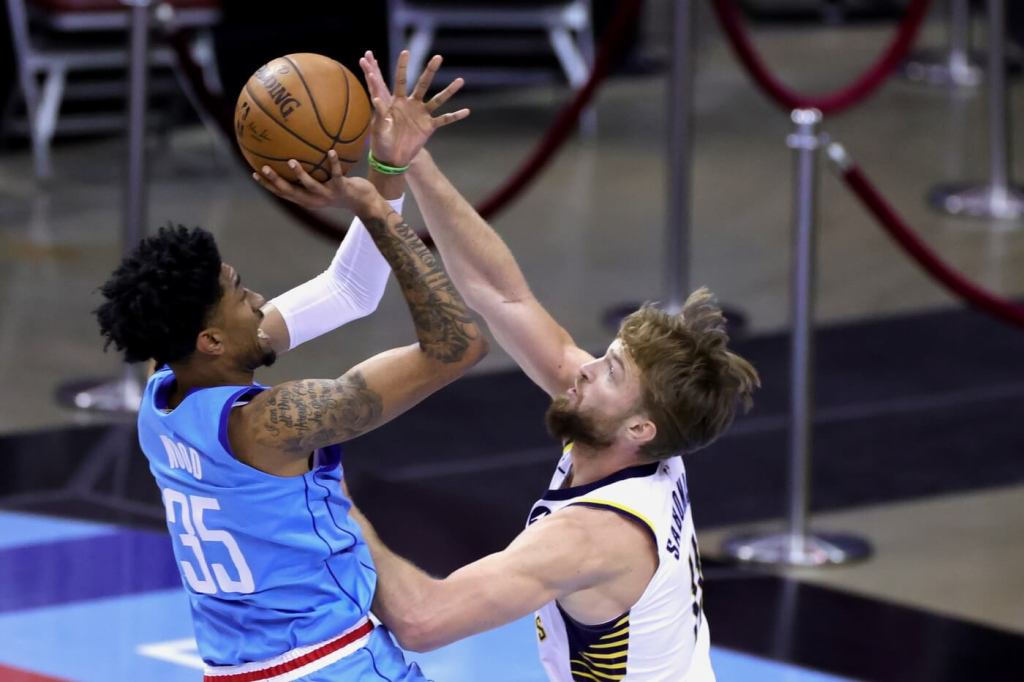 Apr 14, 2021; Houston, Texas, USA; Christian Wood #35 of the Houston Rockets shoots a basket over Domantas Sabonis #11 of the Indiana Pacers during the first quarter at Toyota Center. Mandatory Credit: Carmen Mandato/POOL PHOTOS-USA TODAY Sports