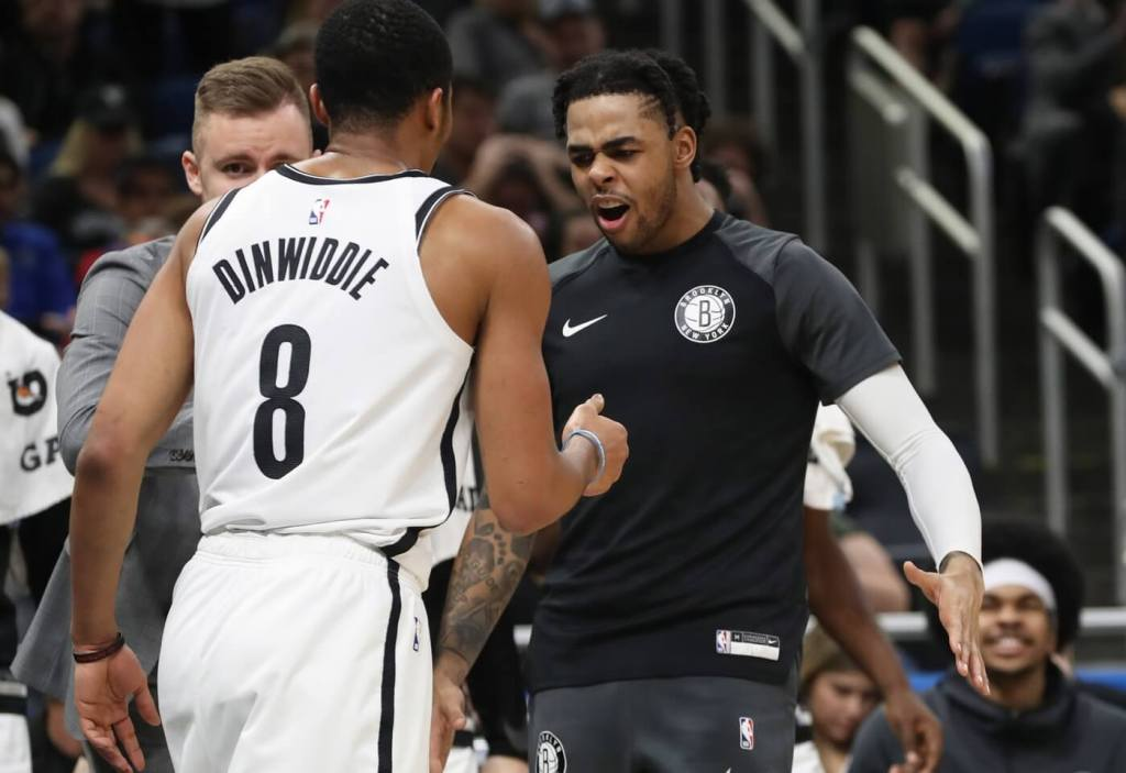 Jan 18, 2019; Orlando, FL, USA; Brooklyn Nets guard D'Angelo Russell (1) and Brooklyn Nets guard Spencer Dinwiddie (8) high five during the second half at Amway Center. Mandatory Credit: Kim Klement-USA TODAY Sports