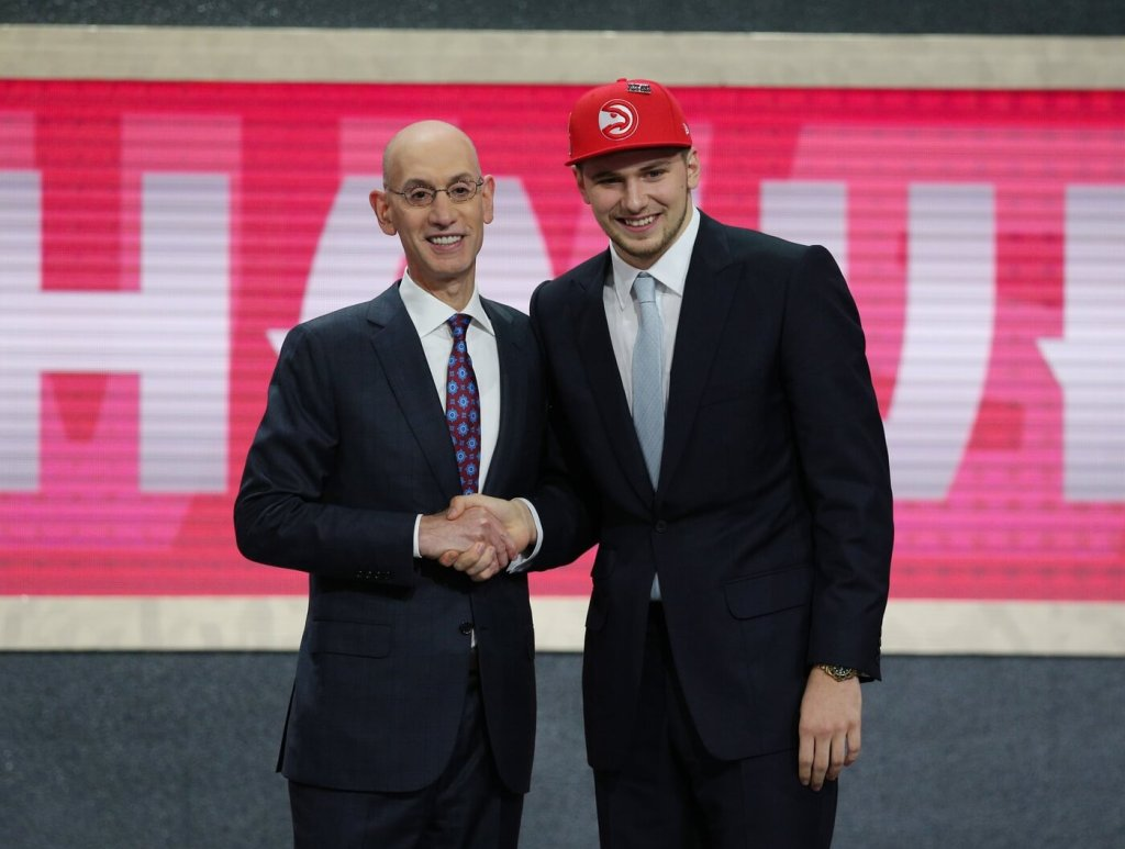 Jun 21, 2018; Brooklyn, NY, USA; Luka Doncic greets NBA commissioner Adam Silver after being selected as the number three overall pick to the Atlanta Hawks in the first round of the 2018 NBA Draft at the Barclays Center. Mandatory Credit: Brad Penner-USA TODAY Sports