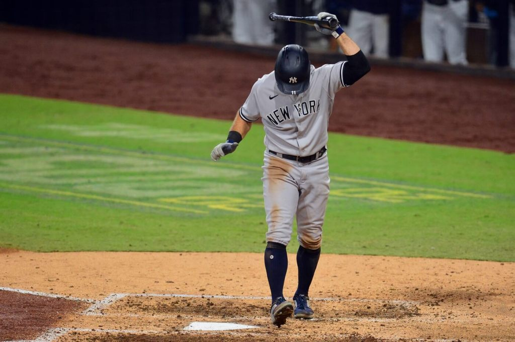 Oct 9, 2020; San Diego, California, USA; New York Yankees left fielder Brett Gardner (11) reacts after striking out against the Tampa Bay Rays to end the top of the seventh inning of game five of the 2020 ALDS at Petco Park. Mandatory Credit: Gary A. Vasquez-USA TODAY Sports