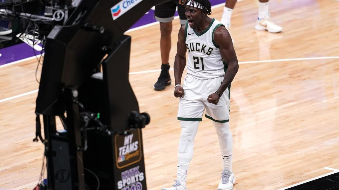 Apr 3, 2021; Sacramento, California, USA; Milwaukee Bucks guard Jrue Holiday (21) reacts after being fouled while making a shot against the Sacramento Kings in the fourth quarter at the Golden 1 Center. Mandatory Credit: Cary Edmondson-USA TODAY Sports