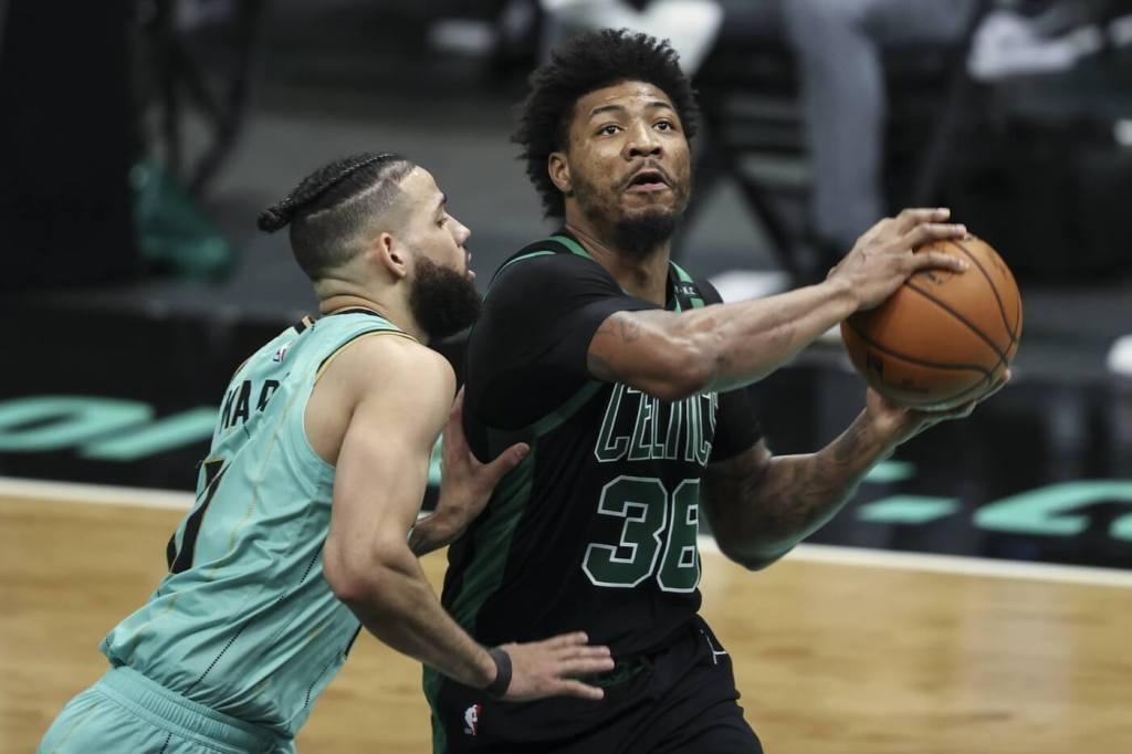 Apr 25, 2021; Charlotte, North Carolina, USA; Boston Celtics guard Marcus Smart (36) looks to shoot against Charlotte Hornets forward Cody Martin (11) during the third quarter at Spectrum Center. Mandatory Credit: Nell Redmond-USA TODAY Sports