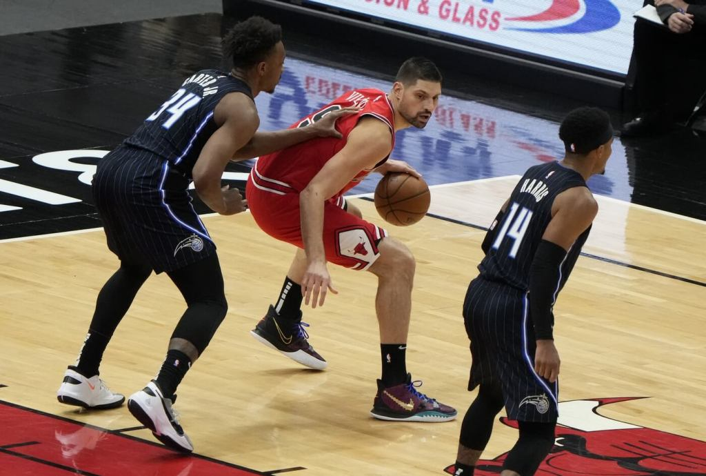 Apr 14, 2021; Chicago, Illinois, USA; Chicago Bulls center Nikola Vucevic (9) dribbles the ball while defended by Orlando Magic center Wendell Carter Jr. (34) during the first quarter at the United Center. Mandatory Credit: Mike Dinovo-USA TODAY Sports