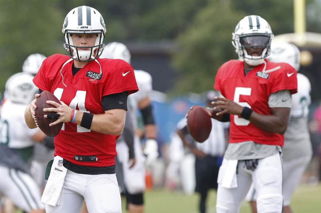 Aug 13, 2018; Washington, DC, USA; New York Jets quarterback Sam Darnold (14) and New York Jets quarterback Teddy Bridgewater (5) participate in drills during a joint practice with the Washington Redskins at Bon Secours Washington Redskins Training Center. Mandatory Credit: Geoff Burke-USA TODAY Sports