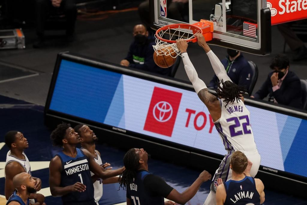 Apr 5, 2021; Minneapolis, Minnesota, USA; Sacramento Kings center Richaun Holmes (22) dunks against the Minnesota Timberwolves in the second quarter at Target Center. Mandatory Credit: Brad Rempel-USA TODAY Sports