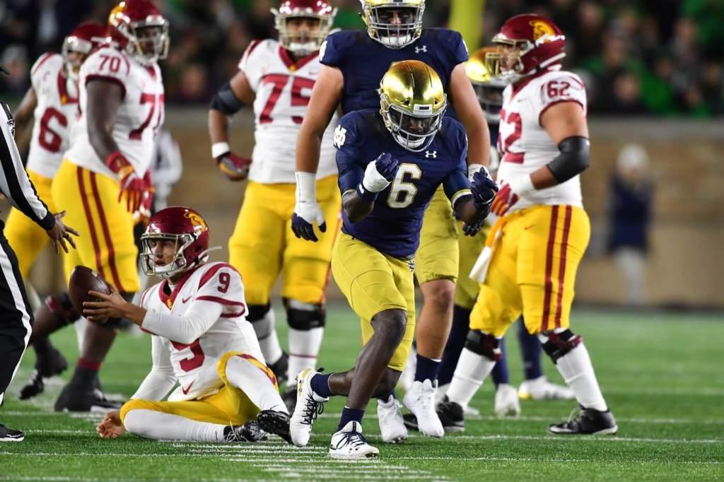 Notre Dame Fighting Irish defensive back Jeremiah Owusu-Koramoah (6) celebrates after sacking USC Trojans quarterback Kedon Slovis (9) in the first quarter at Notre Dame Stadium.