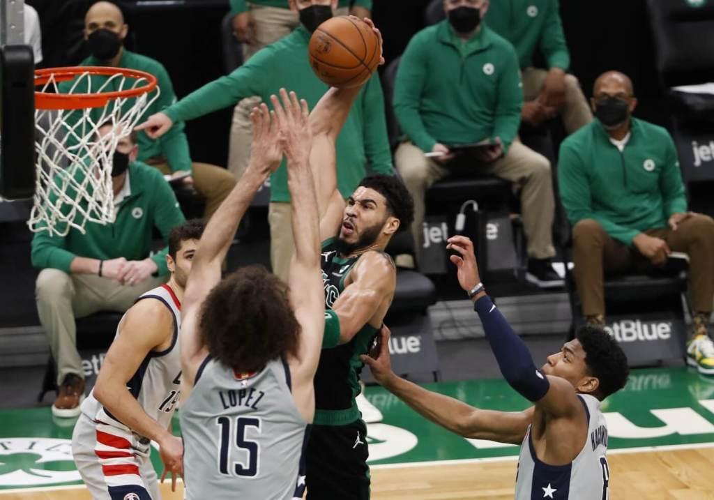 Feb 28, 2021; Boston, Massachusetts, USA; Boston Celtics forward Jayson Tatum (0) goes to the basket against Washington Wizards center Robin Lopez (15) during the second quarter at TD Garden. Mandatory Credit: Winslow Townson-USA TODAY Sports