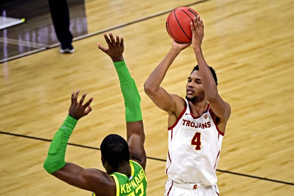 Mar 28, 2021; Indianapolis, Indiana, USA; USC Trojans forward Evan Mobley (4) shoots the ball Oregon Ducks center Franck Kepnang (22) during the second half in the Sweet Sixteen of the 2021 NCAA Tournament at Bankers Life Fieldhouse. Mandatory Credit: Marc Lebryk-USA TODAY Sports