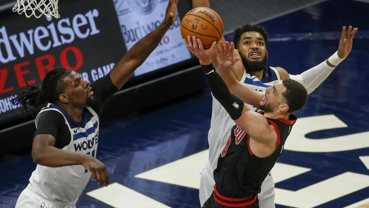 Apr 11, 2021; Minneapolis, Minnesota, USA; Chicago Bulls guard Zach LaVine (8) goes to the basket while defended by Minnesota Timberwolves center Karl-Anthony Towns (32) and forward Naz Reid (11) during the second quarter at Target Center. Mandatory Credit: Bruce Kluckhohn-USA TODAY Sports