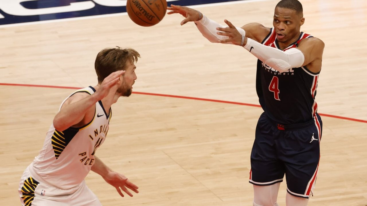 May 3, 2021; Washington, District of Columbia, USA; Washington Wizards guard Russell Westbrook (4) passes the ball as Indiana Pacers forward Domantas Sabonis (11) defends in the second quarter at Capital One Arena. Mandatory Credit: Geoff Burke-USA TODAY Sports