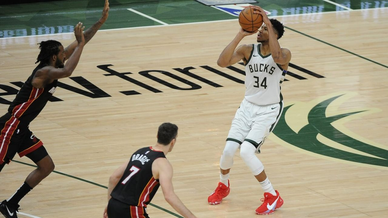 May 15, 2021; Milwaukee, Wisconsin, USA; Milwaukee Bucks forward Giannis Antetokounmpo (34) puts up a three point shot against the Miami Heat n the fourth quarter at Fiserv Forum. Mandatory Credit: Michael McLoone-USA TODAY Sports