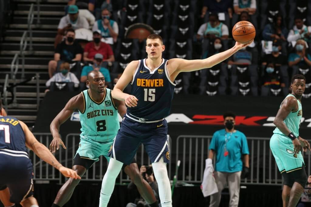 CHARLOTTE, NC - MAY 11:  Nikola Jokic #15 of the Denver Nuggets handles the ball against the Charlotte Hornets on May 11, 2021 at Spectrum Center in Charlotte, North Carolina. NOTE TO USER: User expressly acknowledges and agrees that, by downloading and or using this photograph, User is consenting to the terms and conditions of the Getty Images License Agreement. Mandatory Copyright Notice: Copyright 2021 NBAE (Photo by Kent Smith/NBAE via Getty Images)