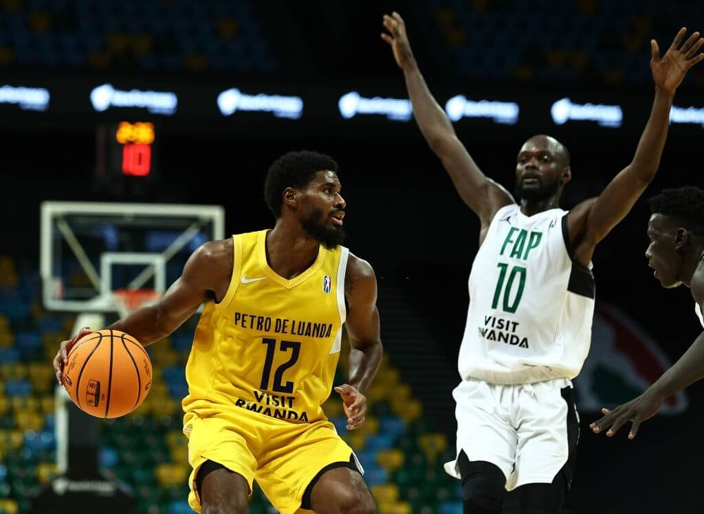 KIGALI, RWANDA - MAY 20: Antwan Scott #12 of Atlético Petróleos de Luanda moves the ball against the Forces Armees et Police Basketball at Kigali Arena on May 20, 2021 in Kigali, Rwanda. (Photo by Nicole Sweet/BAL/Basketball Africa League via Getty Images)