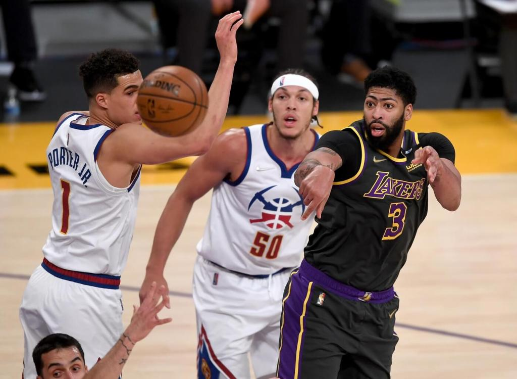 May 3, 2021; Los Angeles, California, USA; Los Angeles Lakers forward Anthony Davis (3) gets off a pass in front of Denver Nuggets forward Michael Porter Jr. (1) and forward Aaron Gordon (50) in the first quarter of the game at Staples Center. Mandatory Credit: Jayne Kamin-Oncea-USA TODAY Sports