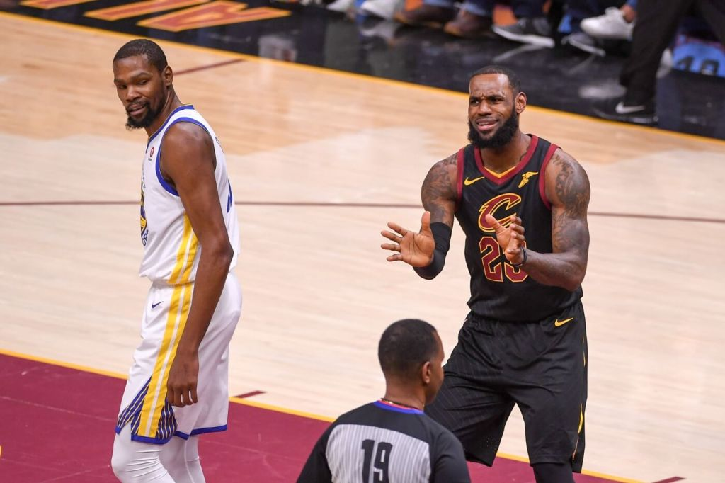 June 8, 2018; Cleveland, OH, USA; Golden State Warriors forward Kevin Durant (35) and Cleveland Cavaliers forward LeBron James (23) react during the first quarter in game four of the 2018 NBA Finals at Quicken Loans Arena. The Warriors defeated the Cavaliers 108-85 to complete a four-game sweep. Surprisingly, neither is one of the most Clutch NBA Players. Mandatory Credit: Kyle Terada-USA TODAY Sports