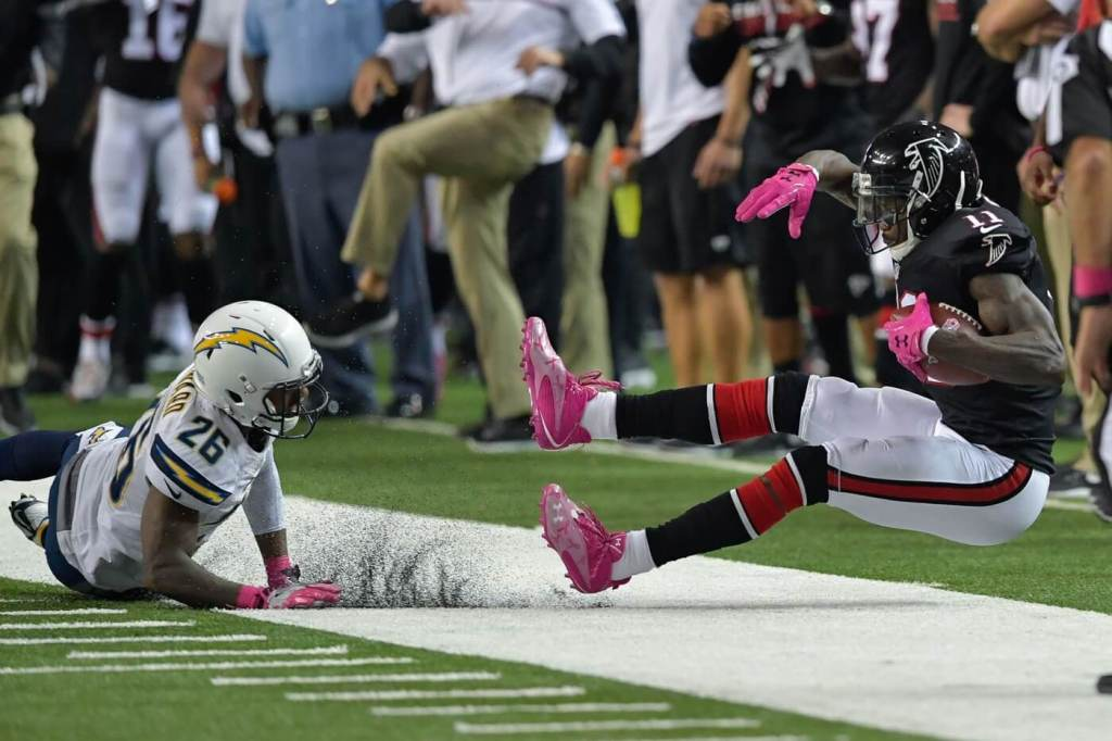 Oct 23, 2016; Atlanta, GA, USA; Atlanta Falcons wide receiver Julio Jones (11) is unable to stay in bounds for a catch against San Diego Chargers cornerback Casey Hayward (26) during overtime at the Georgia Dome. The Chargers defeated the Falcons 33-30 in overtime. Mandatory Credit: Dale Zanine-USA TODAY Sports