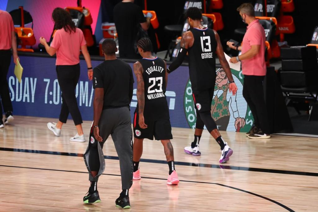 Sep 15, 2020; Lake Buena Vista, Florida, USA; Los Angeles Clippers guard Lou Williams (23) and Paul George (13) walk off the court after losing to the Denver Nuggets in game seven of the second round of the 2020 NBA Playoffs at ESPN Wide World of Sports Complex. Mandatory Credit: Kim Klement-USA TODAY Sports
