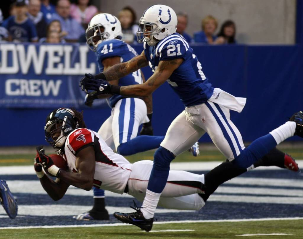 Nov 6, 2011; Indianapolis, IN, USA; Atlanta Falcons wide receiver Julio Jones (11) catches a touchdown pass against Indianapolis Colts defensive back Kevin Thomas (21) during the first quarter at Lucas Oil Stadium. Mandatory Credit: David Kohl-USA TODAY Sports