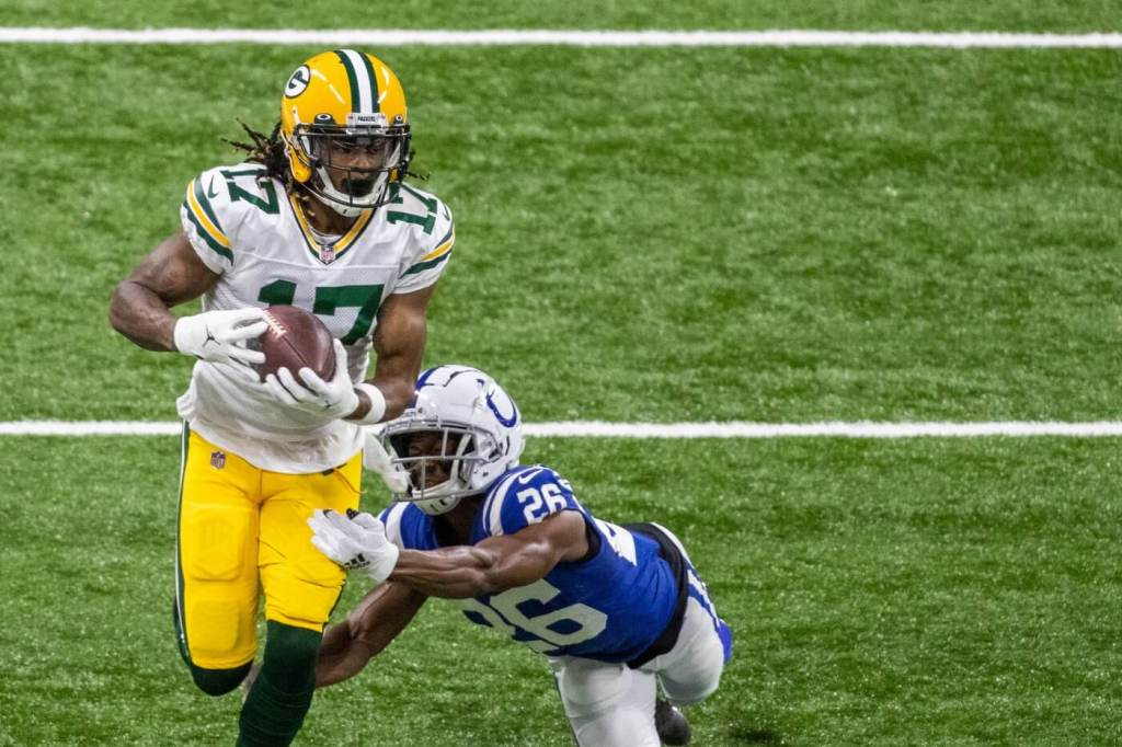 Nov 22, 2020; Indianapolis, Indiana, USA; Green Bay Packers wide receiver Davante Adams (17) runs with the ball after a catch while Indianapolis Colts cornerback Rock Ya-Sin (26) defends in the first half at Lucas Oil Stadium. Mandatory Credit: Trevor Ruszkowski-USA TODAY Sports