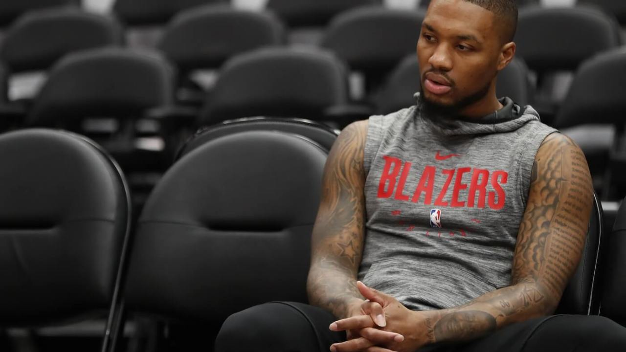 Jan 3, 2020; Washington, District of Columbia, USA; Portland Trail Blazers guard Damian Lillard sits on the bench during a warm up session prior to the Blazers game against the Washington Wizards at Capital One Arena. Mandatory Credit: Geoff Burke-USA TODAY Sports