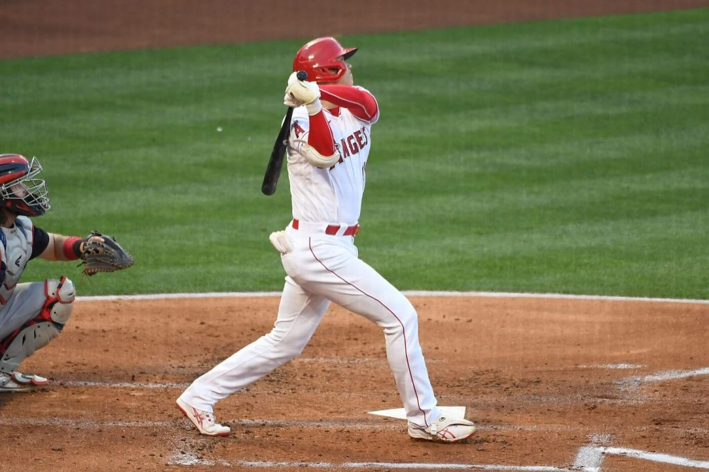 May 18, 2021; Anaheim, California, USA; Los Angeles Angels designated hitter Shohei Ohtani (17) hits a solo home run against the Cleveland Indians in the first inning at Angel Stadium. Mandatory Credit: Richard Mackson-USA TODAY Sports