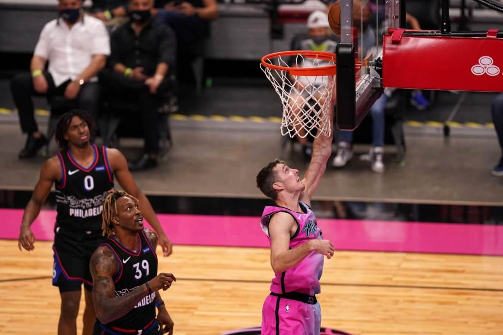 May 13, 2021; Miami, Florida, USA; Miami Heat guard Goran Dragic (7) shoots the ball past Philadelphia 76ers center Dwight Howard (39) during the second half at American Airlines Arena. Mandatory Credit: Jasen Vinlove-USA TODAY Sports