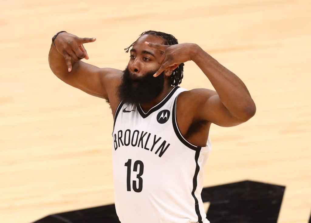 Feb 16, 2021; Phoenix, Arizona, USA; Brooklyn Nets guard James Harden (13) reacts after a three pointer against the Phoenix Suns in the fourth quarter at Phoenix Suns Arena. Looking like one of the most Clutch NBA Players. Mandatory Credit: Mark J. Rebilas-USA TODAY Sports