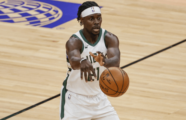 Apr 30, 2021; Chicago, Illinois, USA; Milwaukee Bucks guard Jrue Holiday (21) passes the ball against the Chicago Bulls during the first half of an NBA basketball game at United Center. Mandatory Credit: Kamil Krzaczynski-USA TODAY Sports