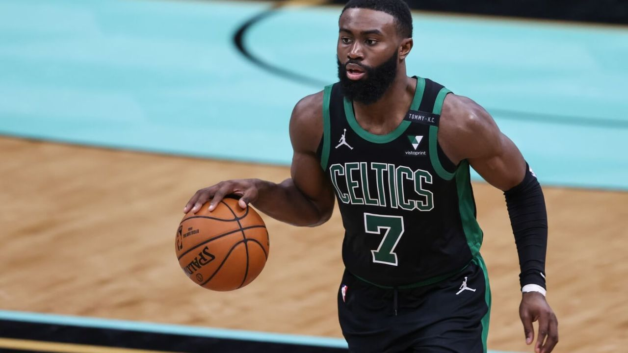 Apr 25, 2021; Charlotte, North Carolina, USA; Boston Celtics guard Jaylen Brown (7) brings the ball up court against the Charlotte Hornets in the second half at Spectrum Center. The Charlotte Hornets won 125-104. Mandatory Credit: Nell Redmond-USA TODAY Sports