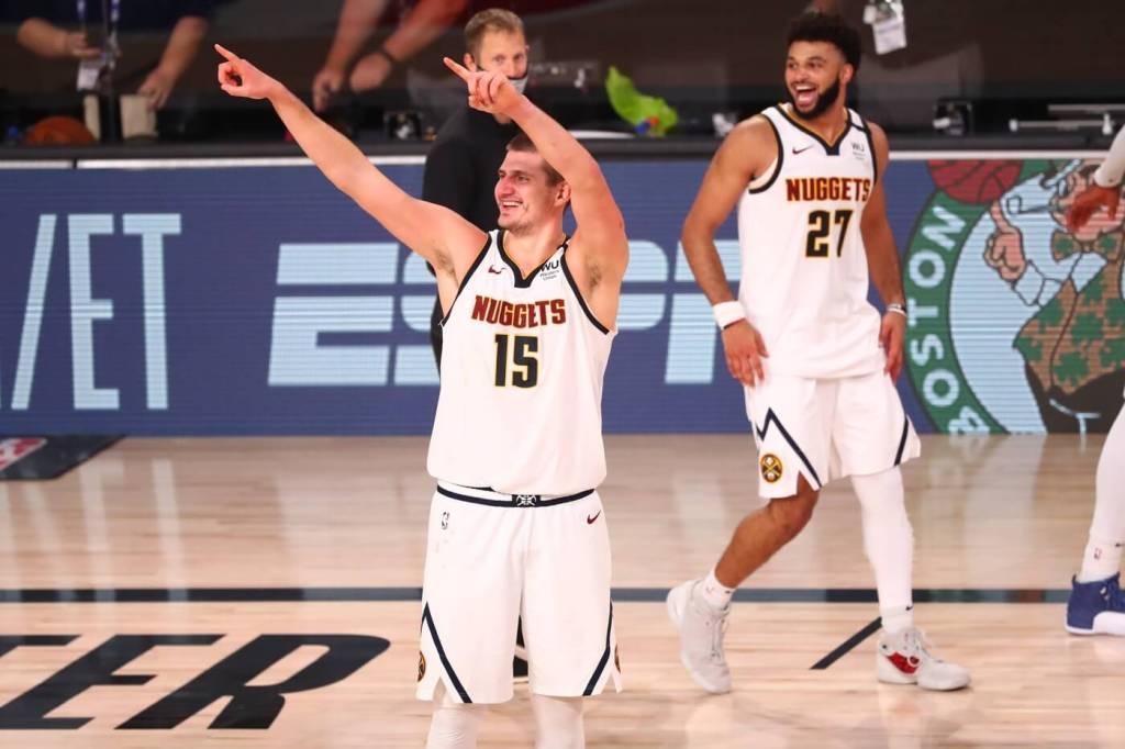 Sep 15, 2020; Lake Buena Vista, Florida, USA; Denver Nuggets center Nikola Jokic (15) celebrates after defeating the Los Angeles Clippers in game seven of the second round of the 2020 NBA Playoffs at ESPN Wide World of Sports Complex. Mandatory Credit: Kim Klement-USA TODAY Sports
