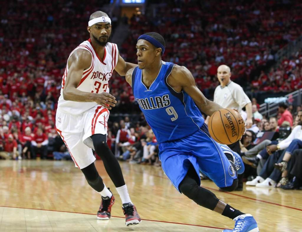 Apr 18, 2015; Houston, TX, USA; Dallas Mavericks guard Rajon Rondo (9) and Houston Rockets guard Corey Brewer (33) in game one of the first round of the NBA Playoffs at Toyota Center. Mandatory Credit: Troy Taormina-USA TODAY Sports
