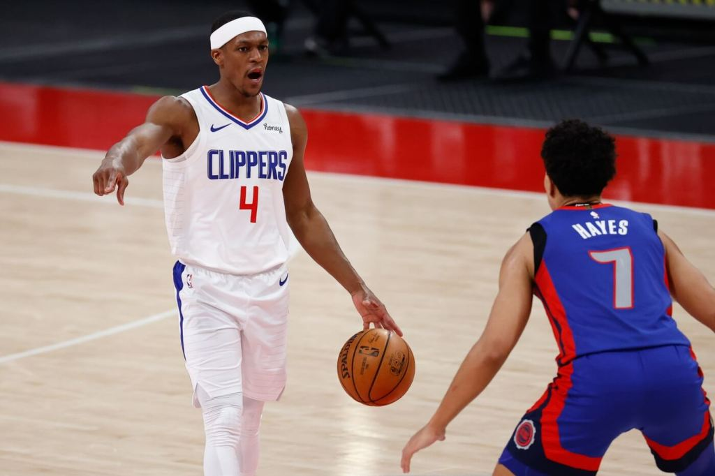 Apr 14, 2021; Detroit, Michigan, USA; LA Clippers guard Rajon Rondo (4) dribbles defended by Detroit Pistons guard Killian Hayes (7) in the second half at Little Caesars Arena. Mandatory Credit: Rick Osentoski-USA TODAY Sports