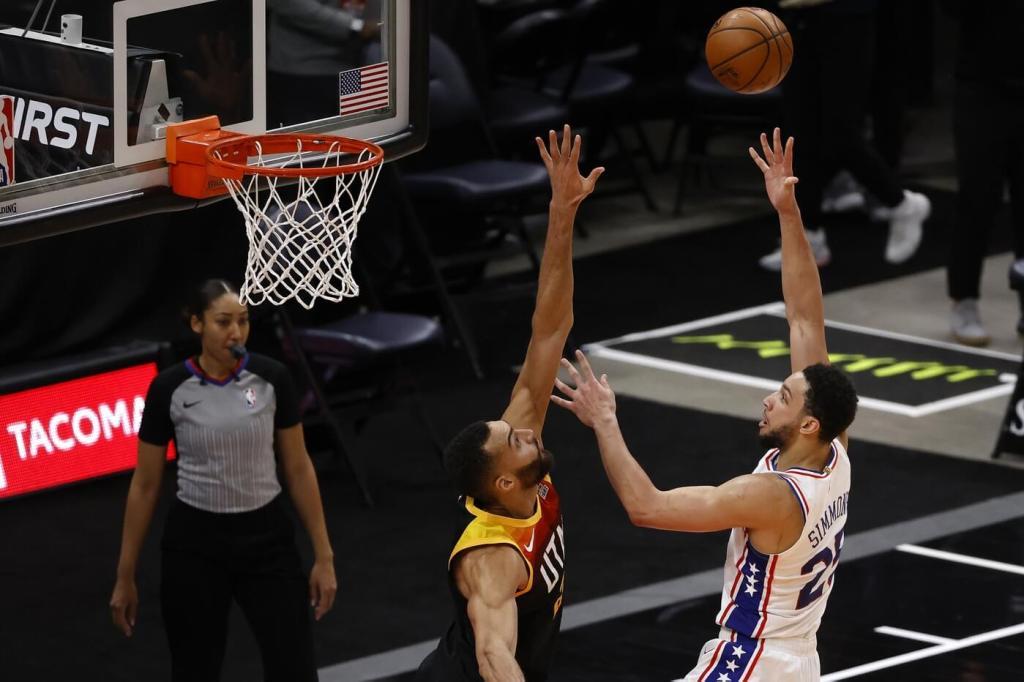 Feb 15, 2021; Salt Lake City, Utah, USA; Philadelphia 76ers guard Ben Simmons (25) shoots over Utah Jazz center Rudy Gobert (27) in the third quarter at Vivint Smart Home Arena. Mandatory Credit: Jeffrey Swinger-USA TODAY Sports